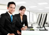 13516248-happy-woman-and-man-office-worker-working-in-the-office.jpg