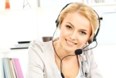 19686710-portrait-of-smiling-young-woman-operator-in-headset-at-office.jpg
